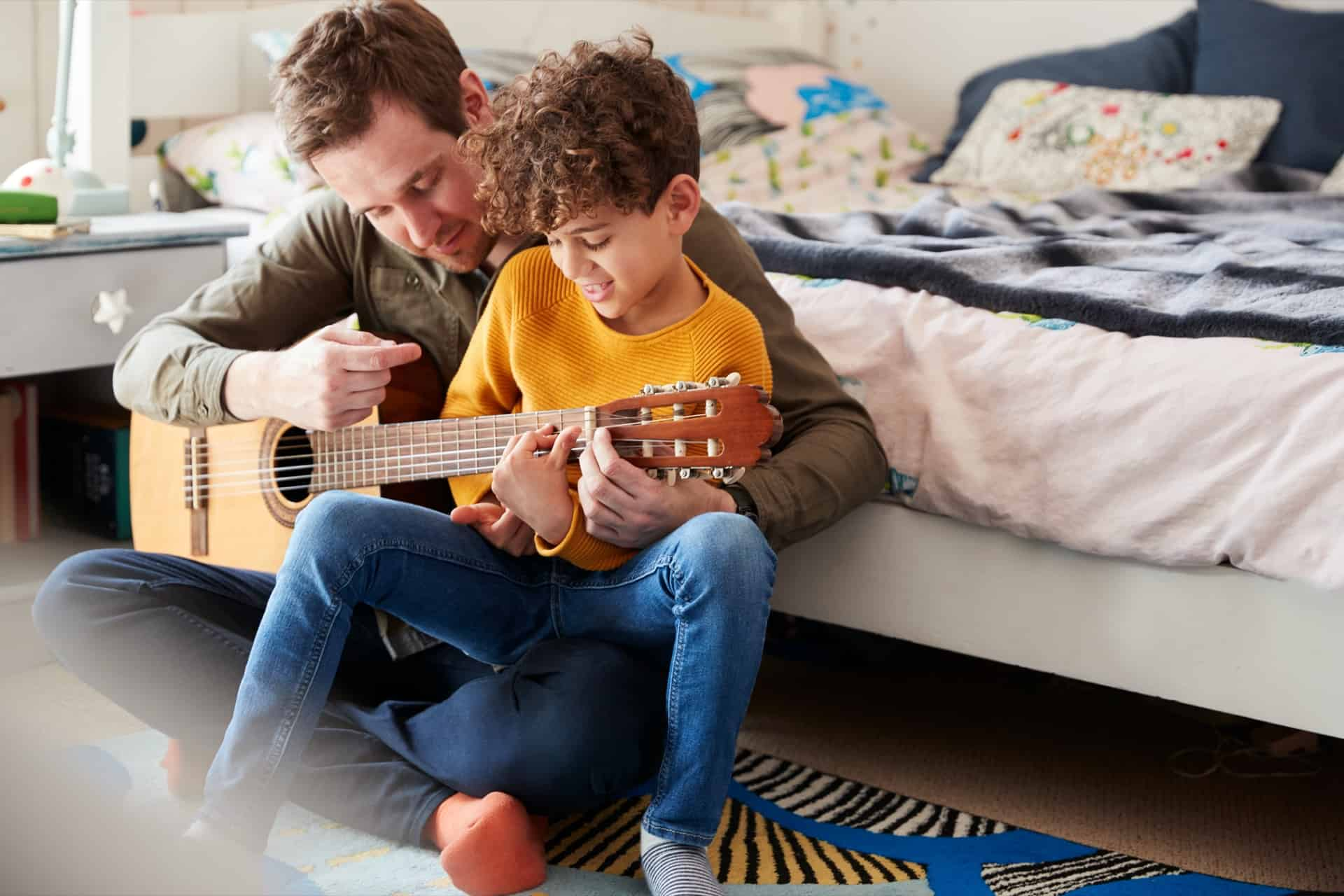 single father at home with son teaching him to NU3GXMK - 5 Boredom Busters to Keep the Family Entertained At Home